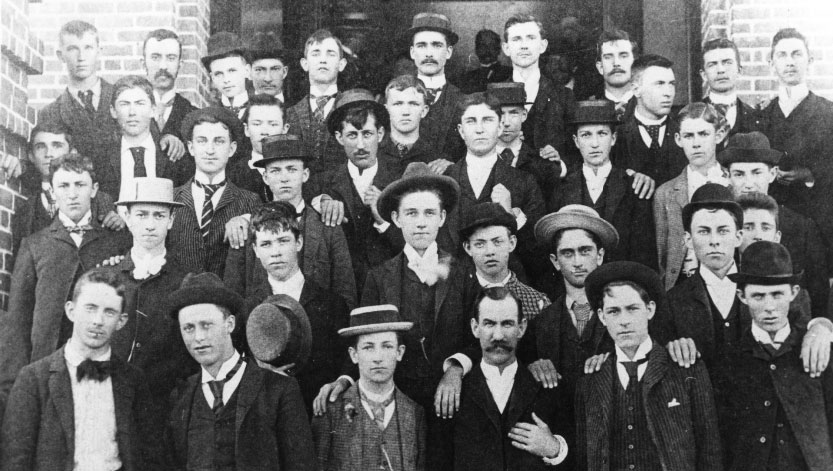 black and white photo of first graduating class at Holladay Hall