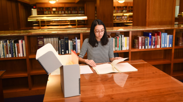 Anna Spencer in DH Hill library